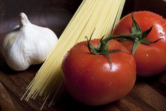 Tomatos and garlic Royalty Free Stock Photos