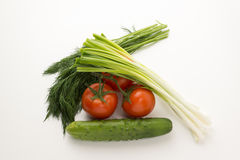 Tomatos and green vegetable Royalty Free Stock Image