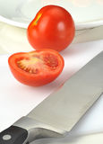 Tomatos with knife Stock Photography