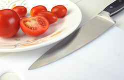 Tomatos with knife Stock Photos