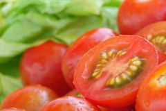 Tomatos and lettuce. Fresh delicious lettuce and tomatos composition Royalty Free Stock Photography