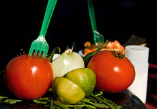 Tomatos and limes on food stand Stock Images