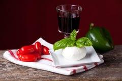 Tomatos and mozzarella Stock Images