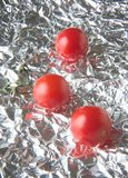 Tomatos reflected Stock Images