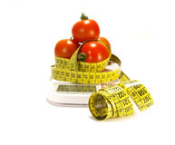 Tomatos and tape measure isolated Stock Images