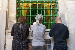 Tomb of Abraham. HEBRON, ISRAEL, 10 OCT, 2014: Three jewish people are praying in front of the tomb of patriarch Abraham. The tombs of the patriarchs are Royalty Free Stock Photo