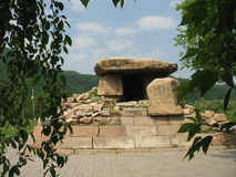 Tomb of Ancient Koguryo Kingdo. In the southwestern reaches of Jilin Province of China lies the small town of Ji an. Here, between the hills, can be found the Royalty Free Stock Photos