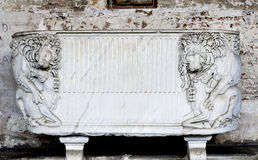 Tomb Artifact - Lions (Campo Santo - Pisa). This is a detail photo of an old roman tomb, with a sculpture relief representation in front, depicting a scene from Stock Images