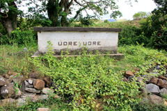 Tomb of cannibal chief Udre Udre, Fiji,2015. Historic tomb of village's cannibal chief Udre Udre, with stones surrounding the grave, meant to symbolize the 999 Stock Image