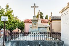 Tomb with cross in Christian cemetery in Malaga Spain stock images