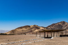 Tomb in the desert. Of Peru with mountains in the back ground stock image