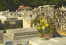 Tomb Flowers. Flowers arrangement on cemetery tomb stock photo