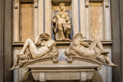 Tomb of Giuliano de Medici and sculptures `Night and Day`. Royalty Free Stock Image