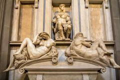 Tomb of Giuliano de Medici and sculptures `Night and Day`. Royalty Free Stock Images