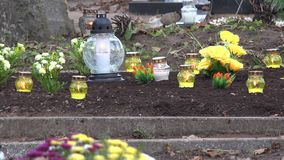 Tomb grave soil full of flowers and candles in religion holiday. 4K stock video footage