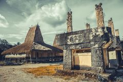 Tomb, hut in the ethnic village. Sumba. Indonesia. royalty free stock images