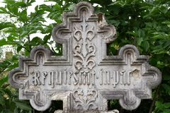 An ornamented stone cross in a cemetery, Rest in Peace written on it in latin, 19th century stock photography