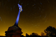 Tomb at night with star trails in the sky Royalty Free Stock Photo