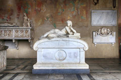 Tomb sculptures on marble tomb in medieval Camposanto Cemetery, Stock Images