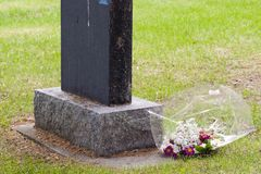 Tomb Stone. A grave stone with flowers Stock Photos