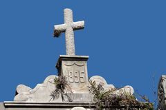 Tomb stone cross Stock Photos