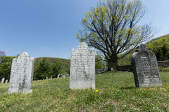 Tomb stone in grave yard stock photography