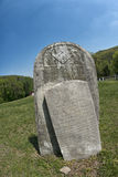 Tomb stone in grave yard Royalty Free Stock Photo