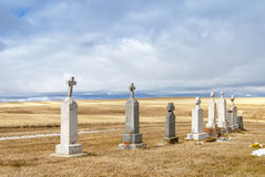 Cemetery amongst wheat fields clouds sky Royalty Free Stock Photos