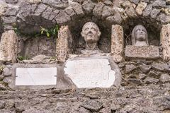 Tomb with three funeral niches in Pompeii, Italy. Tomb with three funeral niches, one empty, at the tomb of the Flavii in Pompeii, Italy stock photos
