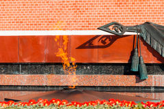 Tomb of Unknown soldier and Eternal flame. MOSCOW, RUSSIA - SEPTEMBER 02, 2016: Tomb of Unknown soldier and Eternal flame in Alexander garden near Kremlin wall Royalty Free Stock Photos