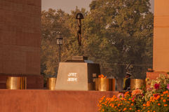 Tomb of the Unknown Soldier at India Gate. This is a black marble plinth, with reversed rifle, capped by war helmet, bounded by four eternal flames. It was built Royalty Free Stock Photos