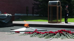 Tomb of the Unknown Soldier. MOSCOW, RUSSIA - MAY 8, 2014: Flowers and honor guard near the monument Tomb of the Unknown Soldier in Alexander Garden. Festive