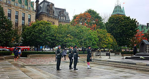 Tomb of the Unknown Soldier Ottawa. OTTAWA, SEP. 30: Ceremonial guards march by the Tomb of the Unknown Soldier at the National War Memorial in Ottawa, Canada on Royalty Free Stock Image