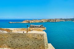 The Tomb of Unknown Soldier, Valletta, Malta. The Tomb of Unknown Soldier of Siege War Memorial at the edge of St Christopher Bastion with  a view on Grand Stock Photo