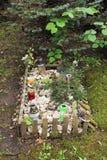 Tomba sul cimitero dell'animale domestico fotografia stock