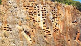 Tombes de roche dans Pinara, Turquie Photos stock