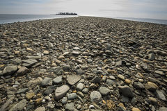 Tombolo of gravel at Silver Sands beach, Milford, Connecticut. Curving spit of glacial gravel deposits leads to Charles Island at Silver Sands Beach in Milford royalty free stock image