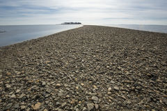 Tombolo of gravel at Silver Sands beach, Milford, Connecticut. Curving spit of glacial gravel deposits leads to Charles Island at Silver Sands Beach in Milford royalty free stock photo