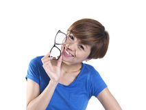 Tomboy looking asian chinese girl holding spectacles Royalty Free Stock Photos
