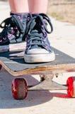 Tomboy on skateboard Royalty Free Stock Photo