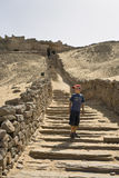 Tombs of the Nobles. Child on the steps leading up to the Tombs of Nobles,Aswan,Egypt stock photo