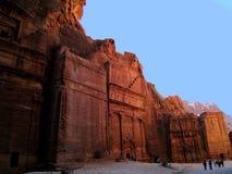 Tombs in Petra, Jordan. Rock-cut Tombs in Petra, Jordan, under blue sky and some tourists Royalty Free Stock Photos