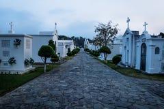 Tombs at the San Lazaro Cemetery, Antigua, Guatemala. Tombs at the San Lazaro Cemetery in dusk, Antigua, Guatemala stock image