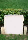 Tombstone. A blank tombstone stands in a cemetary Royalty Free Stock Photos