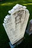 Tombstone. A very old white tombstone in a small village cemetery Stock Image