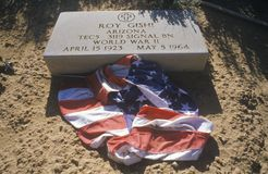 Tombstone and American Flag at the Cemetery, Fort Defiance, Arizona Stock Photo