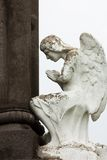 Tombstone with an angel praying Royalty Free Stock Image