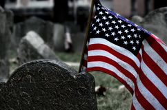 Detail of a tombstone in Boston. Tombstone in Boston cemetery. Resume of the place with USA flag Royalty Free Stock Image