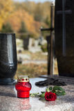 Tombstone with candle Royalty Free Stock Photo