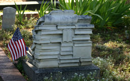 A tombstone carved for an avid reader. Rear view of a tombstone made for someone who obviously loved reading and books. Found at the Old City Cemetery stock photos